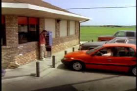Ilustrasi Mobil Merah dengan 3 orang Asing Di dalamnya