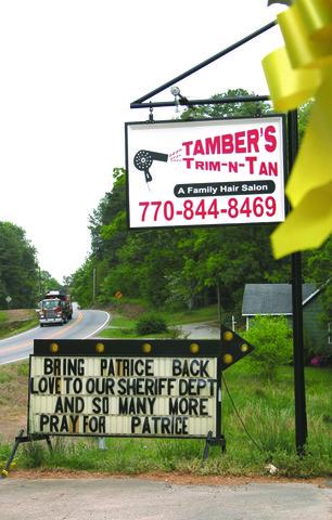 Salon Trim 'n Tan Tamber's Milik Patrice